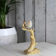 vogel op tak polystone hoog 17.5 cm beige