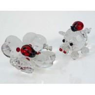 lieveheersbeestje van glas op varken